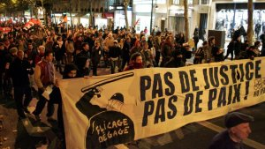 French youth protest police brutality. The banner says,'No justice, no peace!'