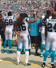 Marcus Ball, number 36, with raised fist;