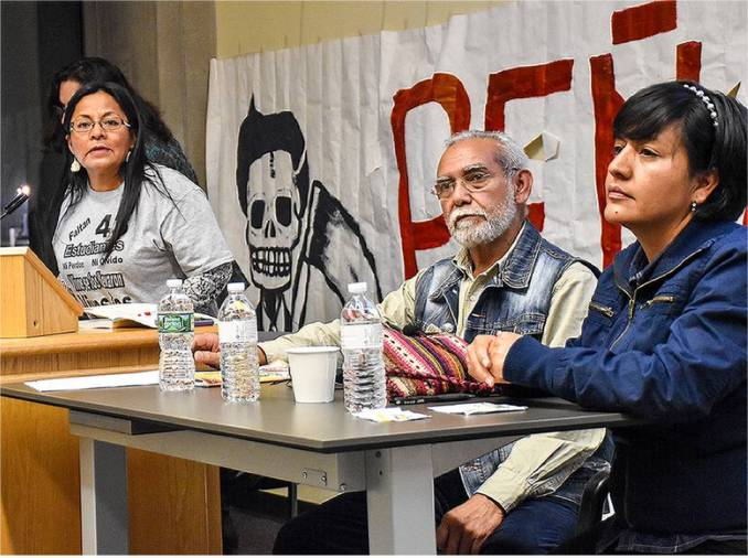 A Philly event organizer, Carmen Guerrero, and Oaxaca teachers Fernando Soberanes Bojórquez and Mayem Arellanes Cano (left to right) at the event.