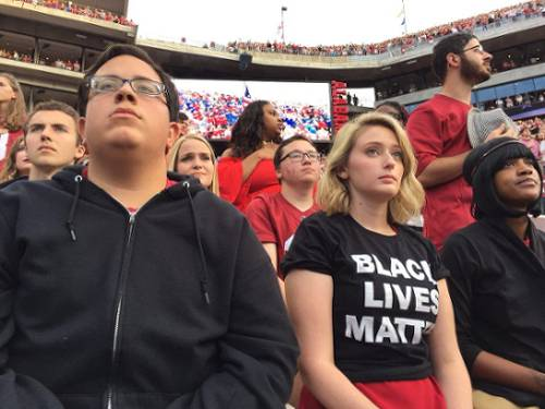 Students refuse to stand during national anthem at first-ranked University of Alabama football game. Tuscaloosa, Oct. 1.