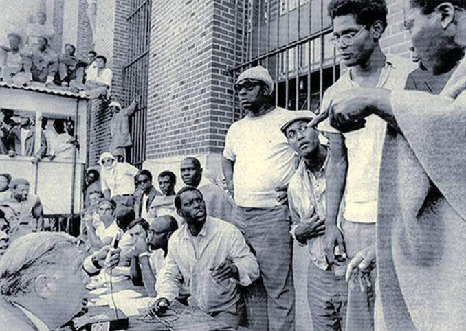 Attica prison inmates negotiate with Commissioner Russell Oswald, lower left.