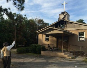 Pastor Bobby Jones outside torched church in Warrenville, S.C.
