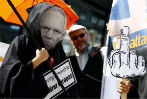 Demonstrator wears Wolfgang Schäuble mask in one of 14 protests in Germany in solidarity with workers in Greece on July 15.