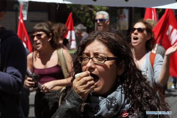 A protester chants slogans during a demonstration in Athens, Greece, on May 6, 2016.