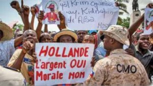 Haitians demonstrate against French president.