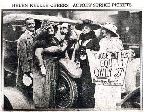 """I am a Socialist because only under socialism can everyone obtain the right to work and be happy."" – Helen Keller, in black hat, supporting actors' strike, 1919."
