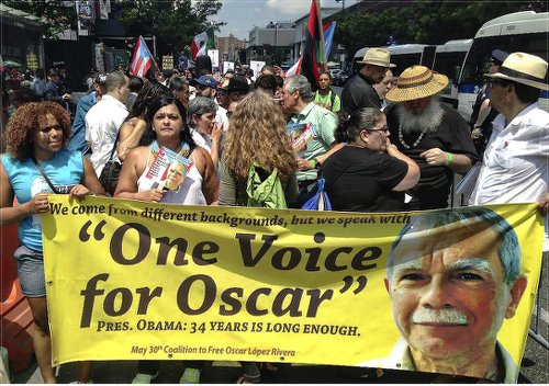 Clarisa López, Oscar's daughter, second from the left, on front banner, NYC, May 30.WW photo: Berta Joubert-Ceci