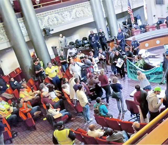 Protesters at Oakland City Council demand a moratorium on evictions.WW photo: Terri Kay