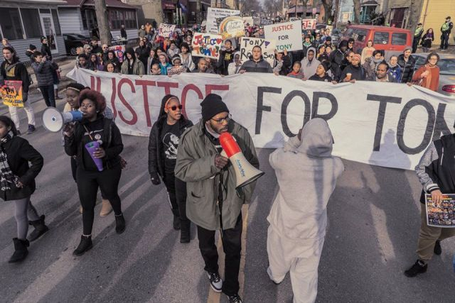 Nate Hamilton of Milwaukee's Coalition For Justice joins protesters in Madison demanding justice for Tony Robinson and all victims of police terror, March 6.Photo: Joe Brusky