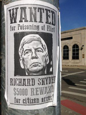 Wanted poster in Southwest Detroit.WW photo: Martha Grevatt