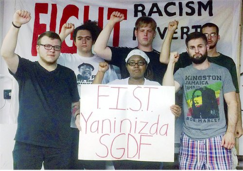 Sign says 'FIST stands with SGDF'