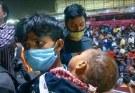 https://www.workersunity.com/wp-content/uploads/2021/04/migrant-labourers-at-Kaushambi-Bus-station.jpg