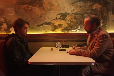 Chase Williamson and Paul Giamatti talk soy sauce.(Courtesy of Magnet Releasing)