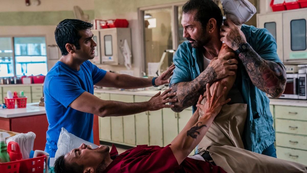 "Kumail Nanjiani as Stu, Dave Bautista as Vic, and Rene Moran as Amo in ""Stuber""."
