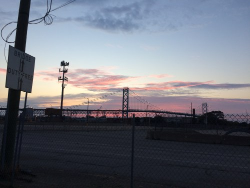 Approaching the Ambassador Bridge to Canada at sunrise.