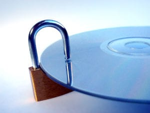 A lock attached to a disk, indicating privacy of information