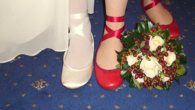 Wedding shoes of different colours but similar ribbons and style