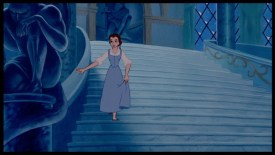 Belle descends staircase in Beast's castle in Winter wearing 3/4 length sleeve dress