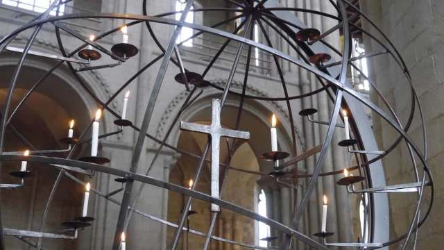 Candles surrounding the cross in Norwich Cathedral