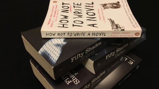 Book of How Not To Write a Novel with copies of Fifty Shades books and Grey