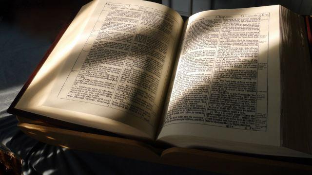 Old English Bible open at Isaiah