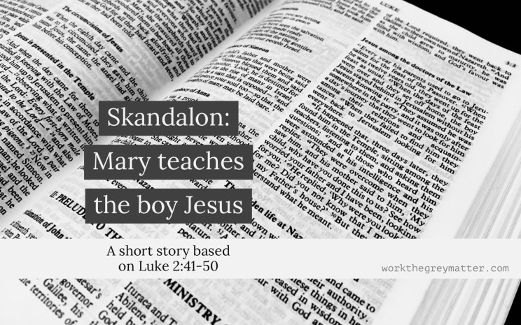 "Bible open at Luke chapter 2 with the words ""Skandalon: Mary teaches the boy Jesus"""