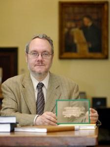 Classics professor Peter van Minnen works with papyri.