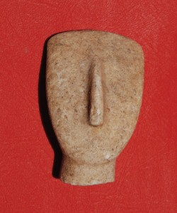 The shield-shaped stone head of an early Cycladic figure, dating to the 3rd millennium BC, from the island of Keros