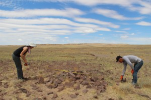 Archaeologists at Ikh Nart measure a Buddhist ovoo (cairn).
