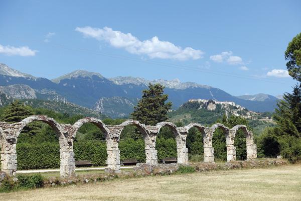 Vista through the abbey remains towards the hilltop town Castel San Vincenzo.