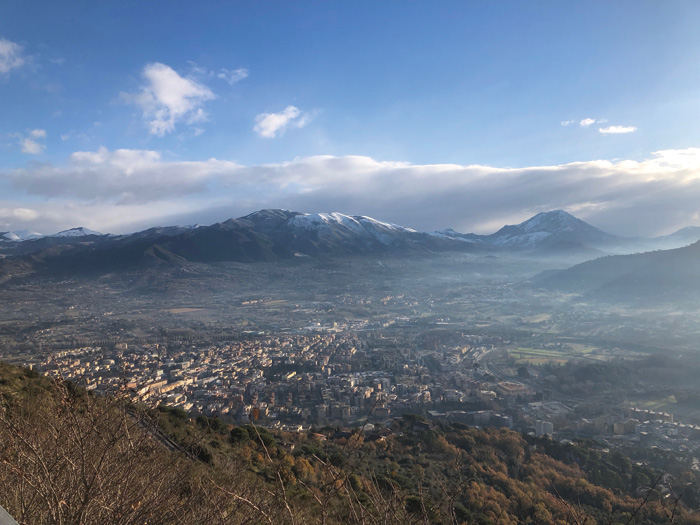 view over town of Cassino, with snow-capped mountains in back ground