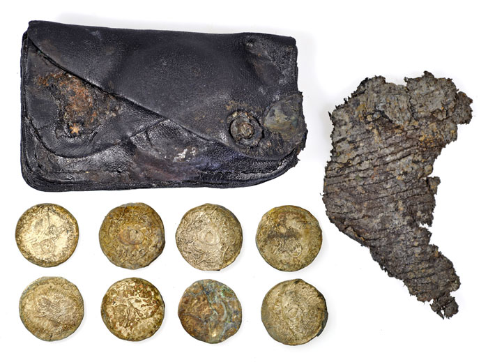 A purse that contained Ottomon and Turkish coins, perhaps from previous service in Gallipoli. [Image: Oxford Archaeology]