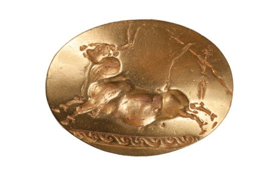 Gold ring engraved with image of a bull and a person leaping over it