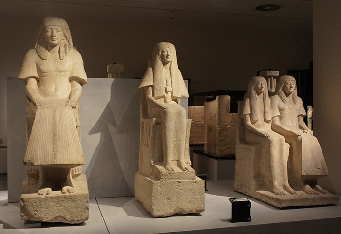 Three statues on display in the museum
