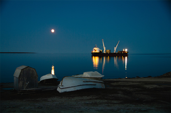 A container ship onthe sea at night