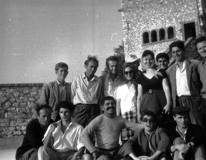 A black-and-white photo of the excavation team
