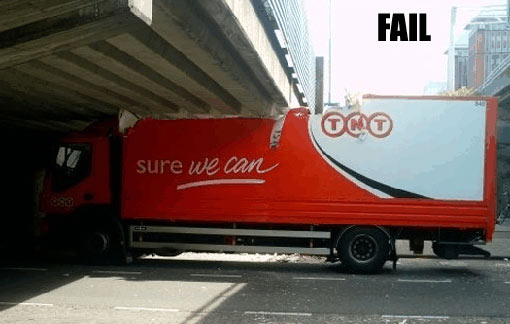 We can do it? Truck stuck under bridge