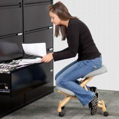 woman on kneeling chair