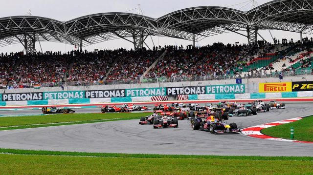 The grid coming out of the first corner at Sepang — f1destinations.com