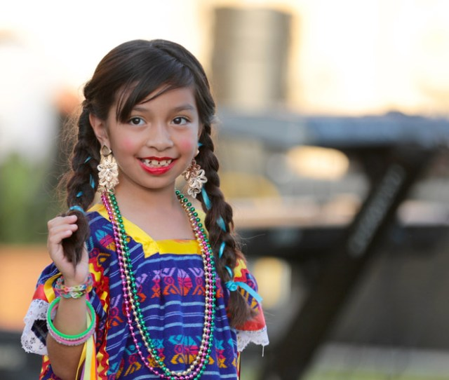 Girl Smiling And Performing At A San Antonio Mission
