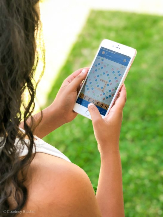 Reese and I spend a lot of time on our phones but that does not mean we're not learning. A few months ago we started playing a game called Words With Friends 2. I love that it's fun for adults and kids and helps keep our spelling sharp. That's why Words With Friends 2 has become our favorite educational mobile app!