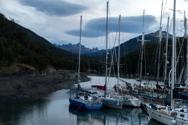 Boats in the harbour of Puerto Williams, the southernmost settlement in the world, with the Dientes de Navarino mountains behind.