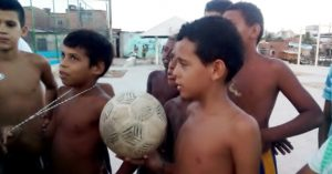 The kids in the favela in Recife talking about football