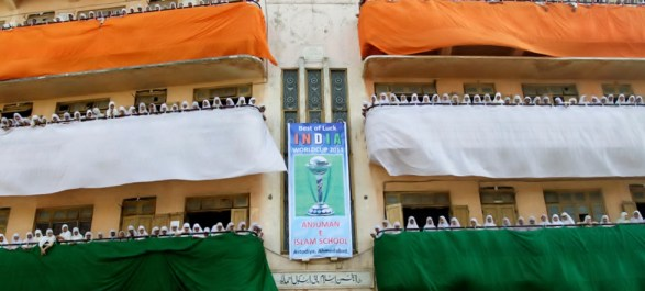 School children in a school in Ahmedabad dress up themselves and decorate their school building premises in the tricolor Indian flag to cheer for the Indian Cricket Team.