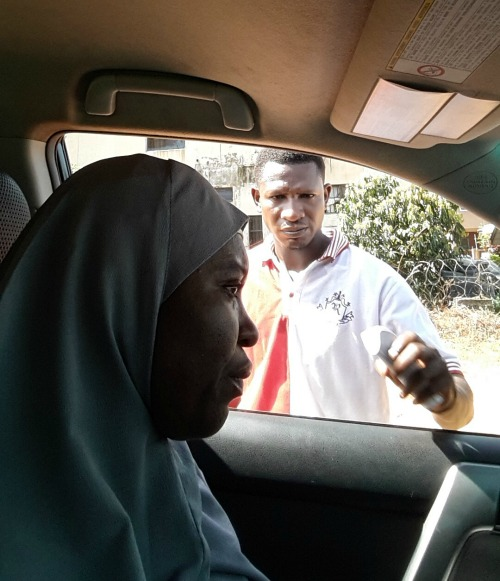 World Mom, Aisha in Nigeria, gets her temperature taken at a stop while driving her daughter to school in northern Nigeria.
