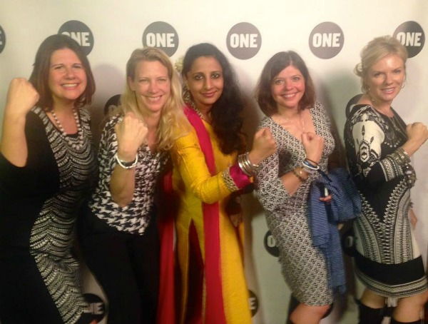 "World Moms pose for a ""Strengthie"" with Neha Misra of Solar Sisters at a ONE Event in NYC in September, 2015."