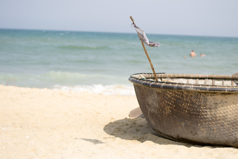 Bamboo basket boat on peaceful An Bang Beach