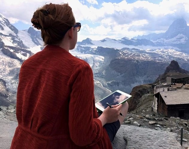 Earning Money While Traveling - Danielle Cady Working While Watching A Mountain