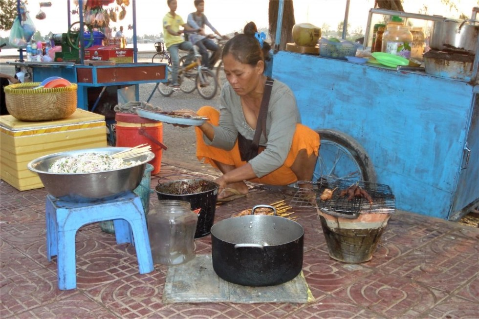 Eating what a Cambodian woman cooks on a sidewalk is one of the advantages of travelling on a budget