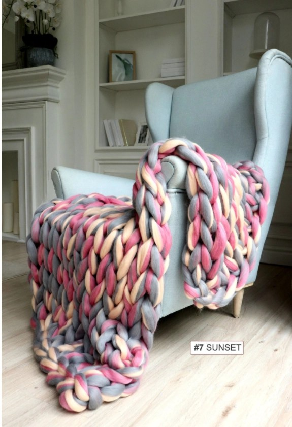 Beautiful Etsy products - chunky knit throw in muted red, yellow and grey on a light green armchair